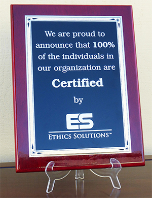 Plaque stating one hundred percent of an oranization are Certified by Ethics Solutions