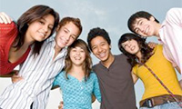 A group of teens broadly smiling