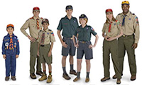 Group of boy scouts and girl scouts with adult leaders